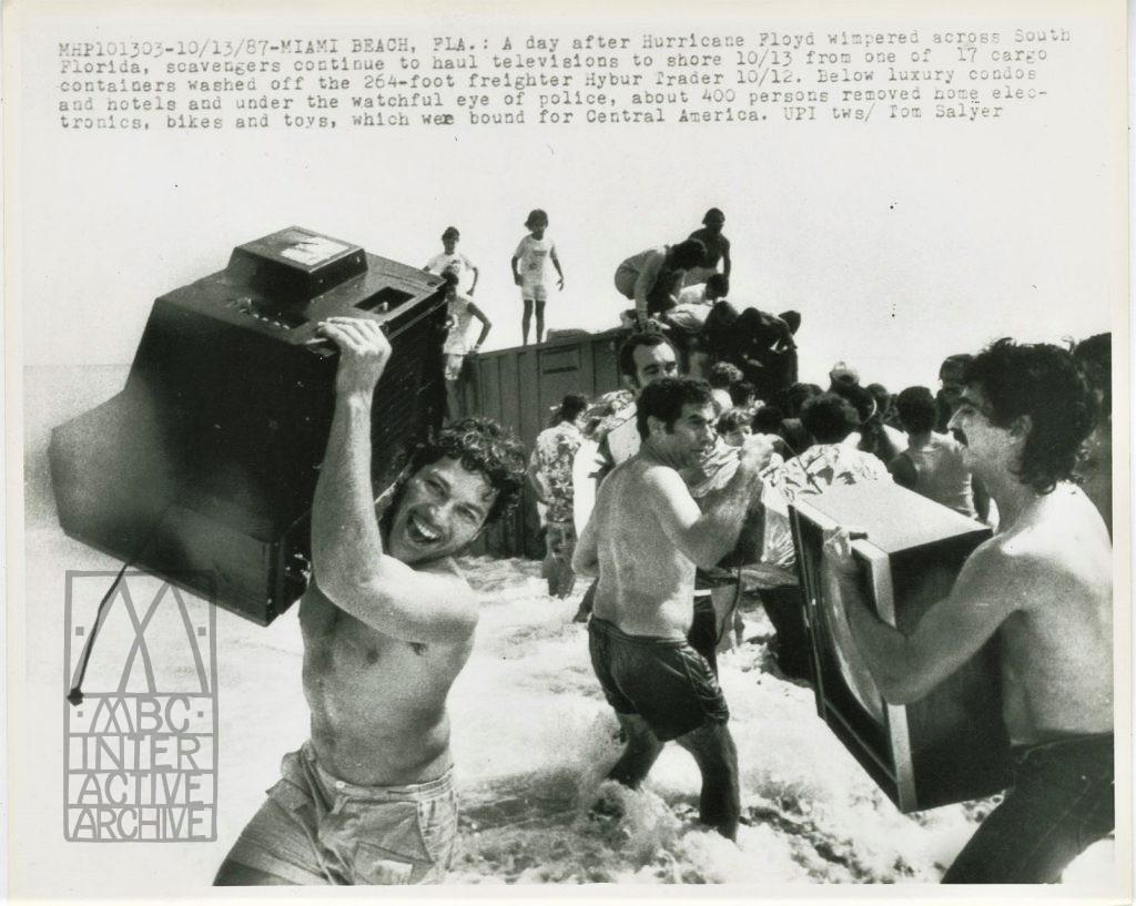 3 Scavengers haul TVs to shore, Miami Beach, OCt 13, 1987. USphoto